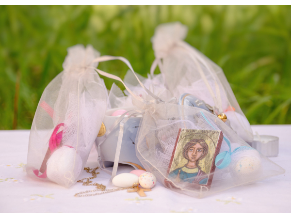 Mini icon favors in an organza bag with almond favors