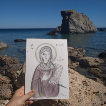 Unframed painting of a saint