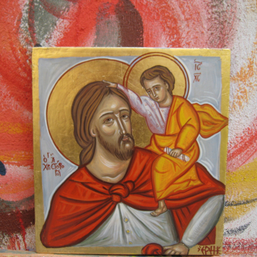 Carrying Christ Child in His back
